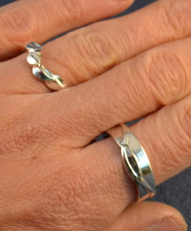 Wedding Bands, the one with 4 leaves interlocks with the Sterling silver and Sapphire ring